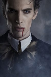 Portrait of a vampire. Halloween theme.